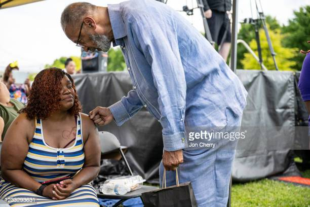 """Religious leader gives Tameka Palmer, Breonna Taylor's mother, words of encouragement during the """"Praise in the Park"""" event at the Big Four Lawn on..."""