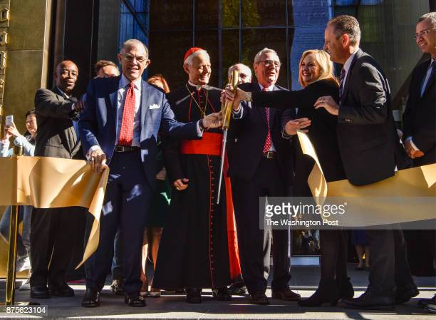 Religious leaders and dignitaries perform one of three ribbon cuttings during the Museum of the Bible's invitation only grand opening on November...