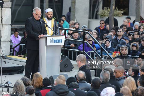 Religious leaders speak during an interfaith vigil at Nathan Phillips Square in memory of the 10 people killed and 15 people injured in a deadly van...