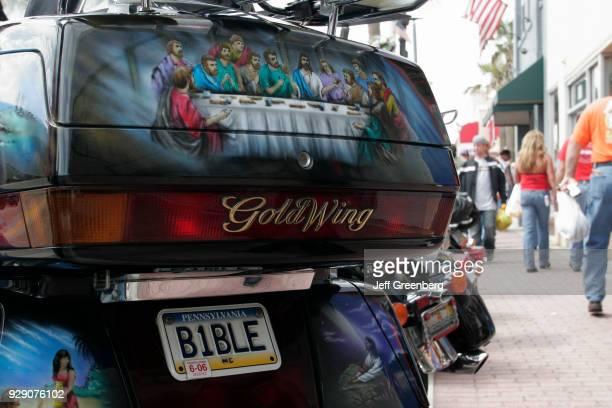 A religious license plate on a bike at Bike Week on Main Street Daytona Beach