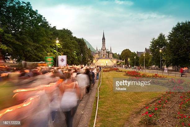 religious march in lourdes - our lady of lourdes stock pictures, royalty-free photos & images