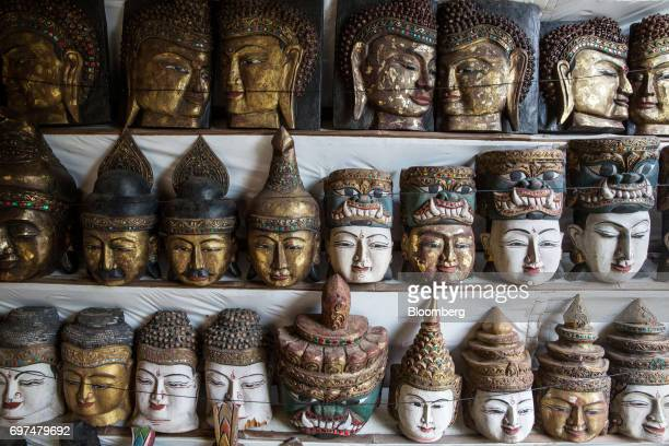 Religious masks sit on display at a Buddhist temple in Bagan Myanmar on Saturday June 10 2017 When the country opened to the outside world in 2011...