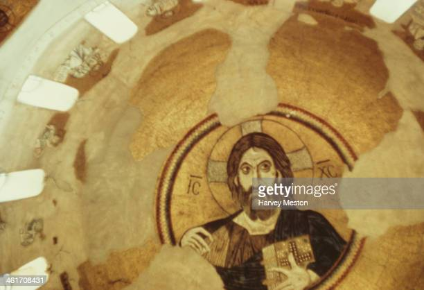 A religious mural in the Daphni Monastery an 11th century Byzantine monastery in Chaidari a suburb of Athens Greece circa 1960 The letters 'ICXC' are...
