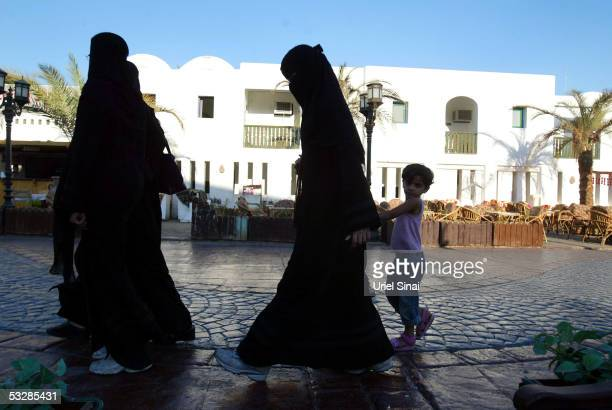 Religious Muslim tourists walk down King of Bahrain promenade on July 25 2005 in the Egyptian Red Sea resort of Sharm elSheikh With foreign tourists...