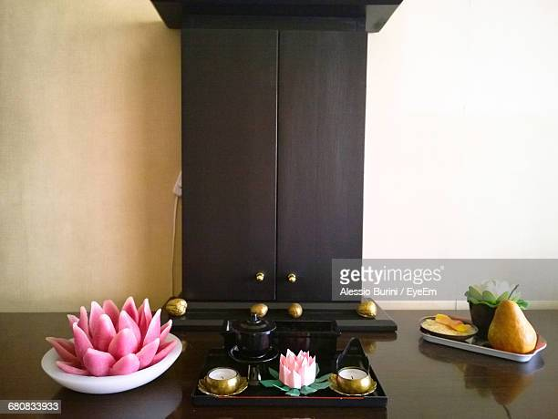 Religious Offerings And Wooden Temple At Home