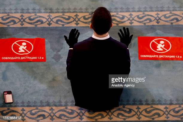 Religious officials perform Eid al-Fitr prayer at the Moscow Central Mosque within precautions against the novel coronavirus pandemic at the Moscow...