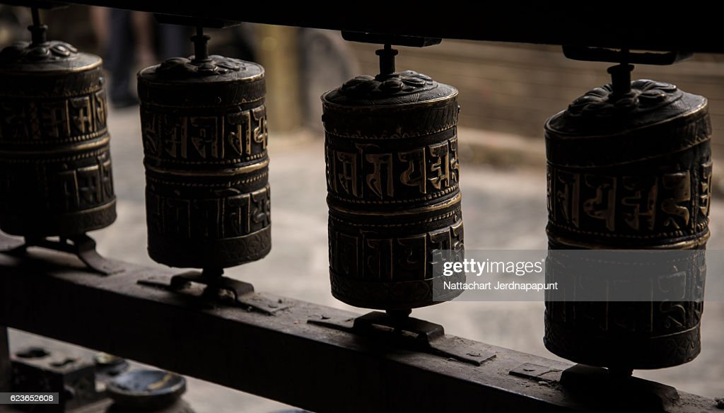 Religious prayer's wheels or prayer's rolls of the faithful Buddhists : Stock Photo