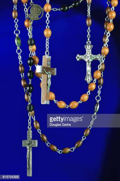 Religious Rosary praying beads on a blue background