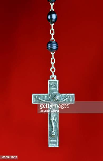 Religious Rosary praying beads on a red background