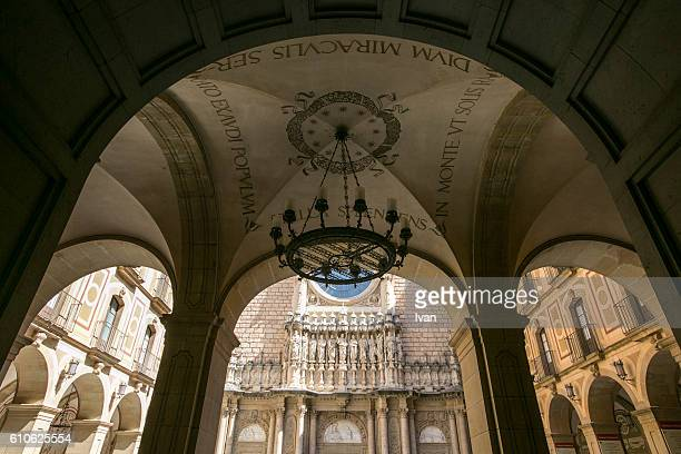 religious sculptures on the faaade of the basilica at the benedictine abbey at montserrat, santa maria de montserrat, near barcelona, catalonia, spain - abby road stock photos and pictures