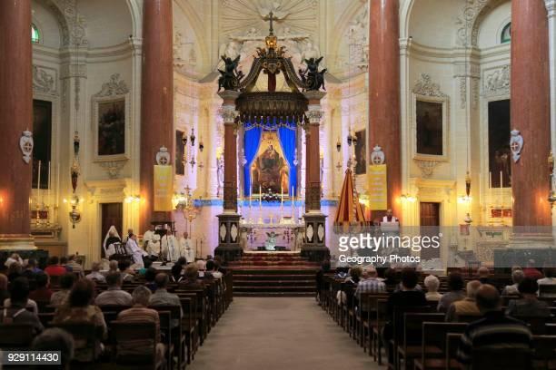 Religious service inside the Carmelite church, Basilica of Our Lady of Mount Carmel, Valletta, Malta.