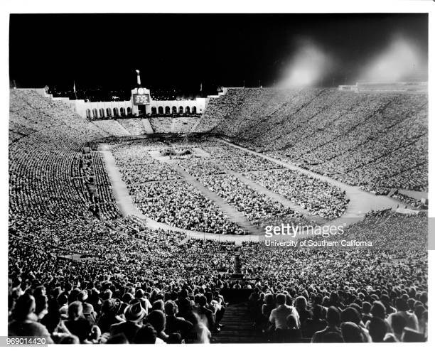 A religious service taking place at night in the Coliseum at Exposition Park Los Angeles California early to mid twentieth century