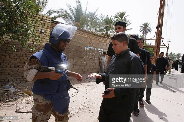 Religious Shias participating in a pilgrimage are tested for traces of explosives by the Iraqi military in the Khadamiya nieghborhood August 8 2007...