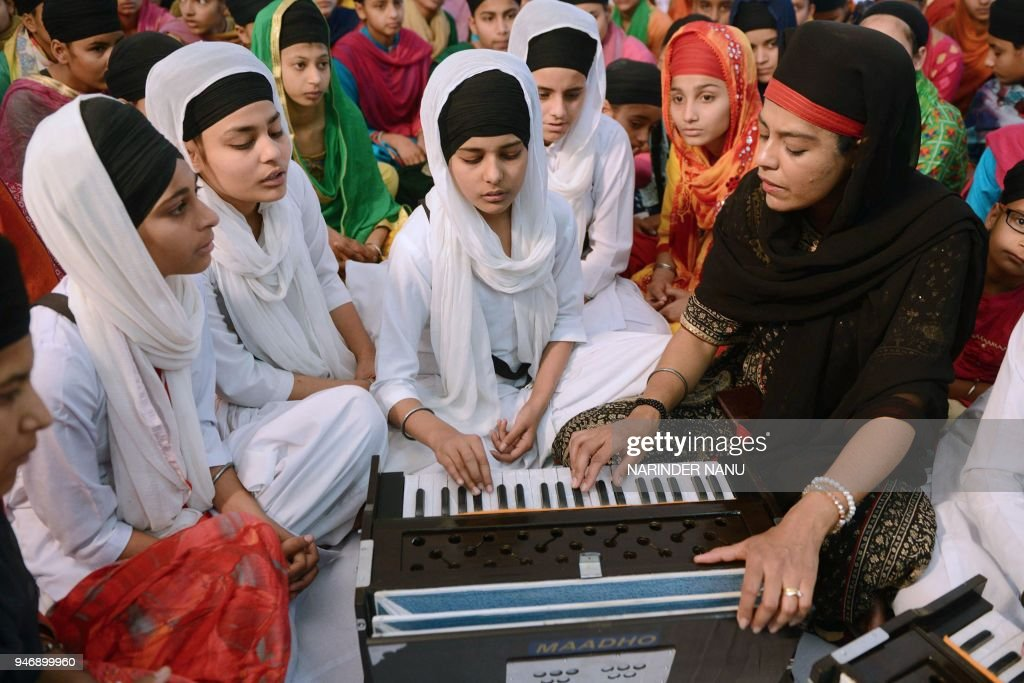 Religious Sikh preacher Ravinder Kaur Tuli of the Canada based music academy `Maadho Music` provides free training of `Kirtan` devotional songs to...