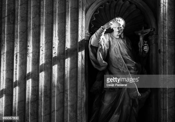 religious statue in st peter basilica. - vatican stock pictures, royalty-free photos & images