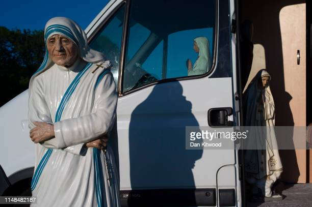 Religious statues stand in and around a campavan during the annual Appleby Horse Fair on June 06, 2019 in Appleby-in-Westmorland, England. The annual...