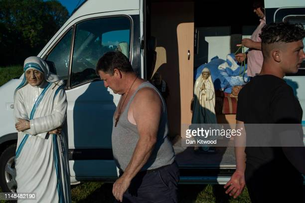 Religious statues stand in and around a campavan during the annual Appleby Horse Fair on June 06 2019 in ApplebyinWestmorland England The annual...