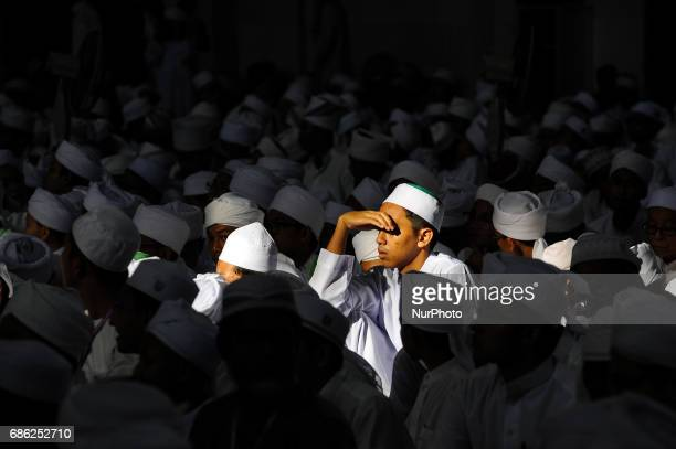 Religious student covering his eye from sun light inside the Federal Territory Mosque during the gathering for students who had successfully...