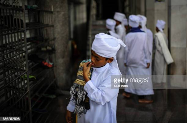 Religious student seen at the corridor of the Federal Territory Mosque during the gathering for students who had successfully memorised the holy...