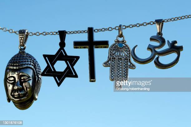 religious symbols of christianity, islam, judaism, buddhism and hinduism, interfaith dialogue, france, europe - religious symbol stock pictures, royalty-free photos & images