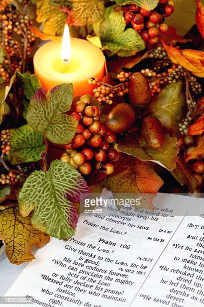 religious: thanksgiving bible scripture with candle and fall decor - happy thanksgiving text stock pictures, royalty-free photos & images