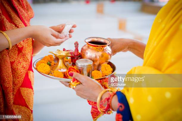 religious women at a hindu temple getting ready for the prayers - ceremony stock pictures, royalty-free photos & images