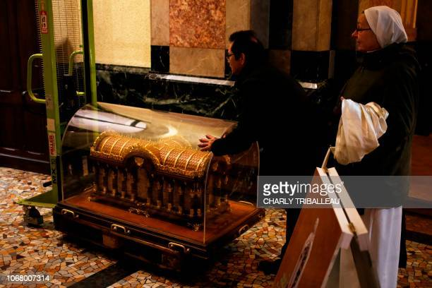 A reliquary of Saint Therese of Lisieux arrives from a 10 weeks tour in the Nordic countries in the Basilica of Lisieux northwestern France on...