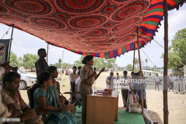 Rema Rajeshwari superintendent of police for the Indian Police Service center addresses villagers at an event to raise awareness on fake news in...