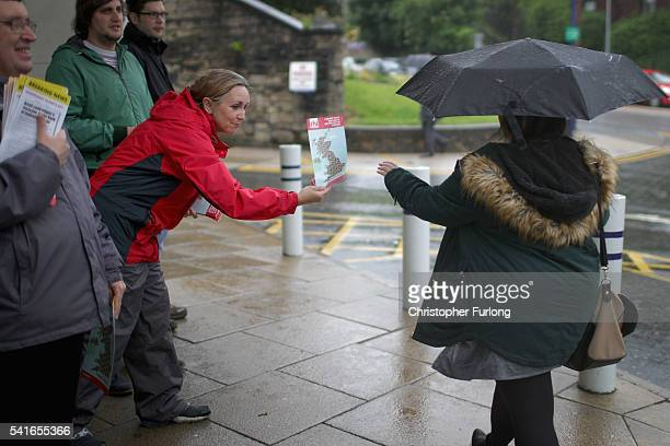 Remain campaigners speak with potential voters as they campaign on behalf of 'Labour In' giving out leaflets to commuters at Stalybridge Railway...