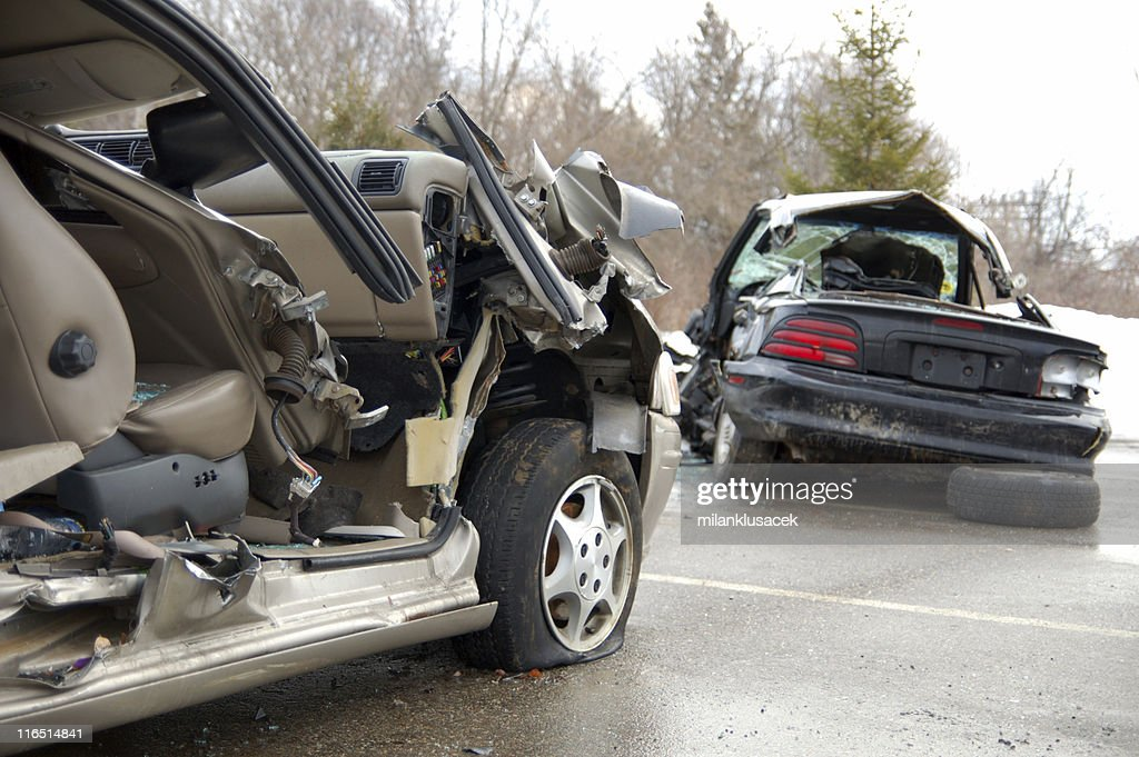 Remaining debris of cars involved in a car crash on road : Stock Photo