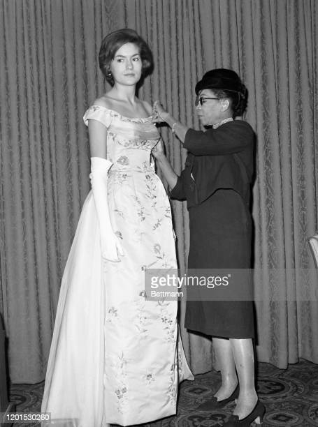 Remaining in the background of the fashion world for 35 years in New York, Ann Lowe, had her first show this year. The designer, adjusting the bodice...