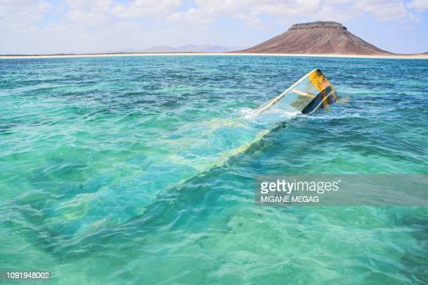 Remaining of a boat floats after the capsizing of two boats earlier this week off Djibouti's northeastern Obock region, on January 31, 2019. - The...