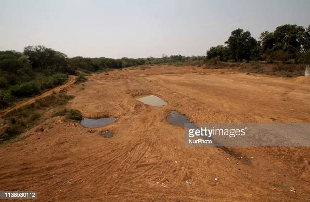 Remaining waters of river is seen at Nabrangpur district of western Odisha state as it dried due to summer season and these are villagers are facing...