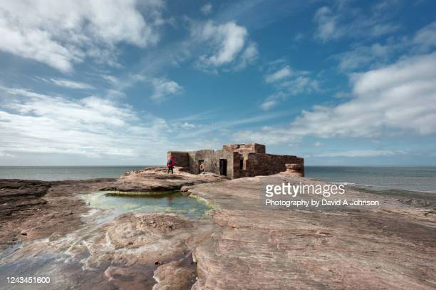remains of a building on hilbre island, merseyside - island stock pictures, royalty-free photos & images