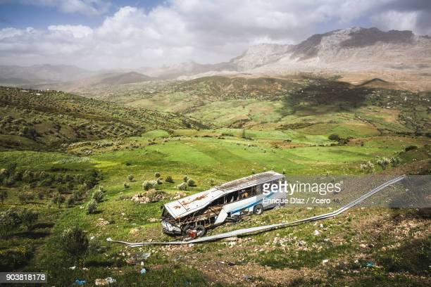 remains of a bus accident in morocco - crash photos stock-fotos und bilder