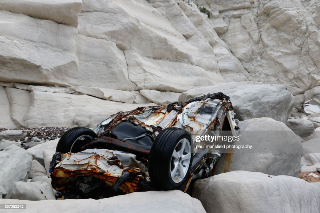 Remains of a car at the foot of Beachy Head : Stock Photo