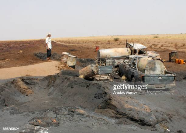 Remains of burnt materials including cars and oil barrels are seen at the explosion site in Al Hudaydah Yemen on April 8 2017 Yesterday unidentified...