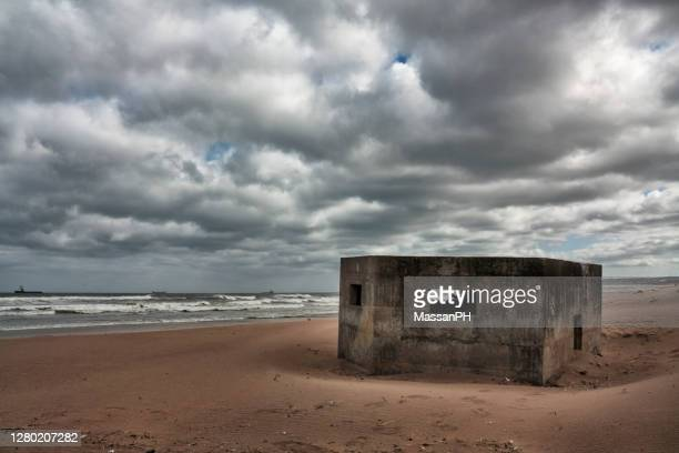 remains of concrete coastal defensive fortifications on the beach north of aberdeen - military stock pictures, royalty-free photos & images