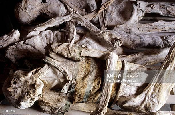Remains of genocide victims lie on display at the Murambi memorial site February 23 2003 in Murambi outside Gikongoro Rwanda 10000 Rwandans who...