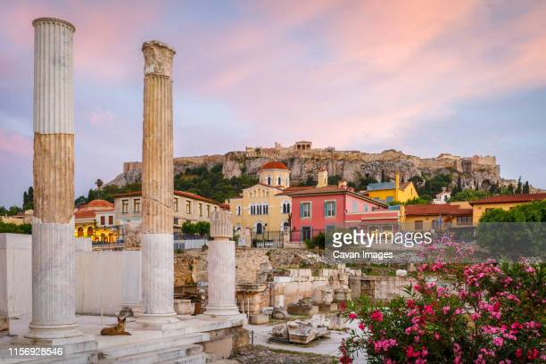 remains of hadrian's library and acropolis in the old town of athens, - アテネ ストックフォトと画像