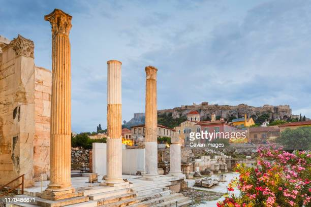 remains of hadrian's library and acropolis in the old town of athens. - old town stock pictures, royalty-free photos & images