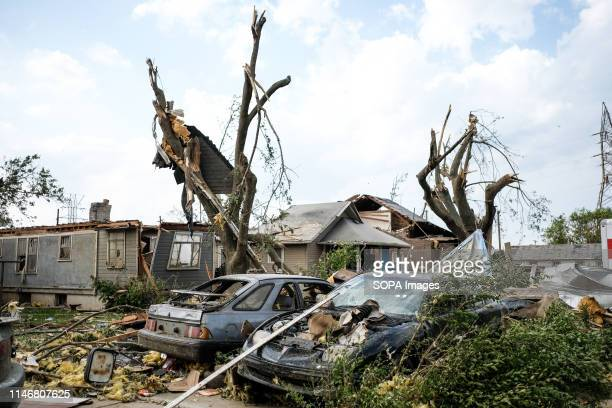 Remains of houses and cars among debris after a tornado struck the area the night before At least 1 person is dead and 12 injured from the storms...