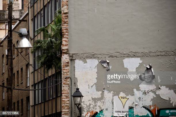 Remains of images of Barcelona local residents are seen hanging next to the historic city wall in the Gothic Quarter on 24 March 2017 Two years ago...