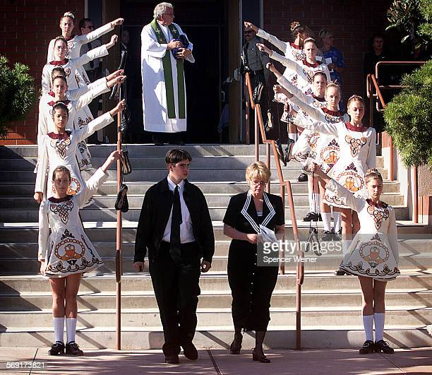 Remains of Megan Barroso are cradled in arms of Rev Gerald Garrett as Suzan Barroso mother of Megan Barroso walks past CLaddagh dance troupe holding...