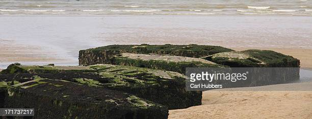 CONTENT] Remains of Mulberry temporary harbour used in D Day in Arrowmanche Normady