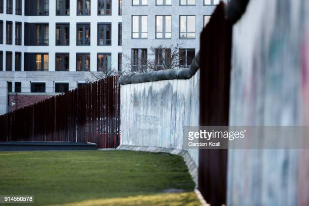Remains of the border wall and iron steles seen at the Berlin Wall memorial at Bernauer Strasse on February 5 2018 in Berlin Germany Today has been...