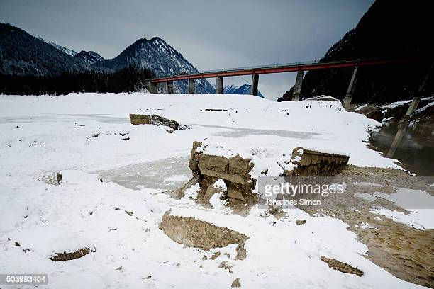 Remains of the former village of Fall lie revealed during low water at Sylvenstein reservoir in Bavaria on January 7 2016 near Lenggries Germany...