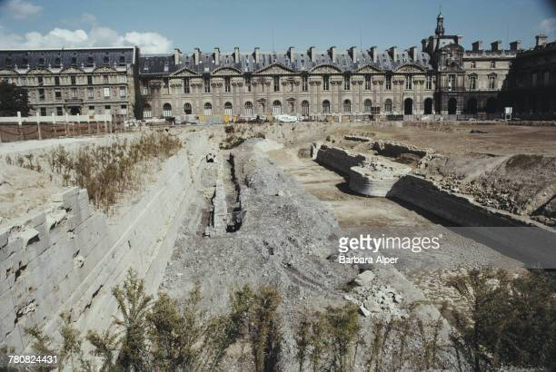 Remains of the original medieval fortress foundations made visible by excavations in a courtyard at the Louvre Palace museum in Paris October 1990