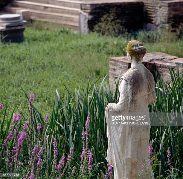 Remains of the Sanctuary of Isis and the goddess statue in the foreground ancient city of Dion Macedonia Greece Hellenistic civilisation
