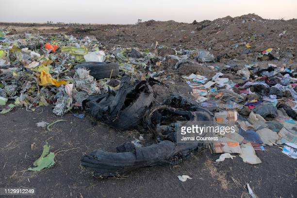 Remains of the tires from Ethiopian Airlines flight ET302 lay in a pile of debris gathered by workers during the continuing recovery efforts at the...